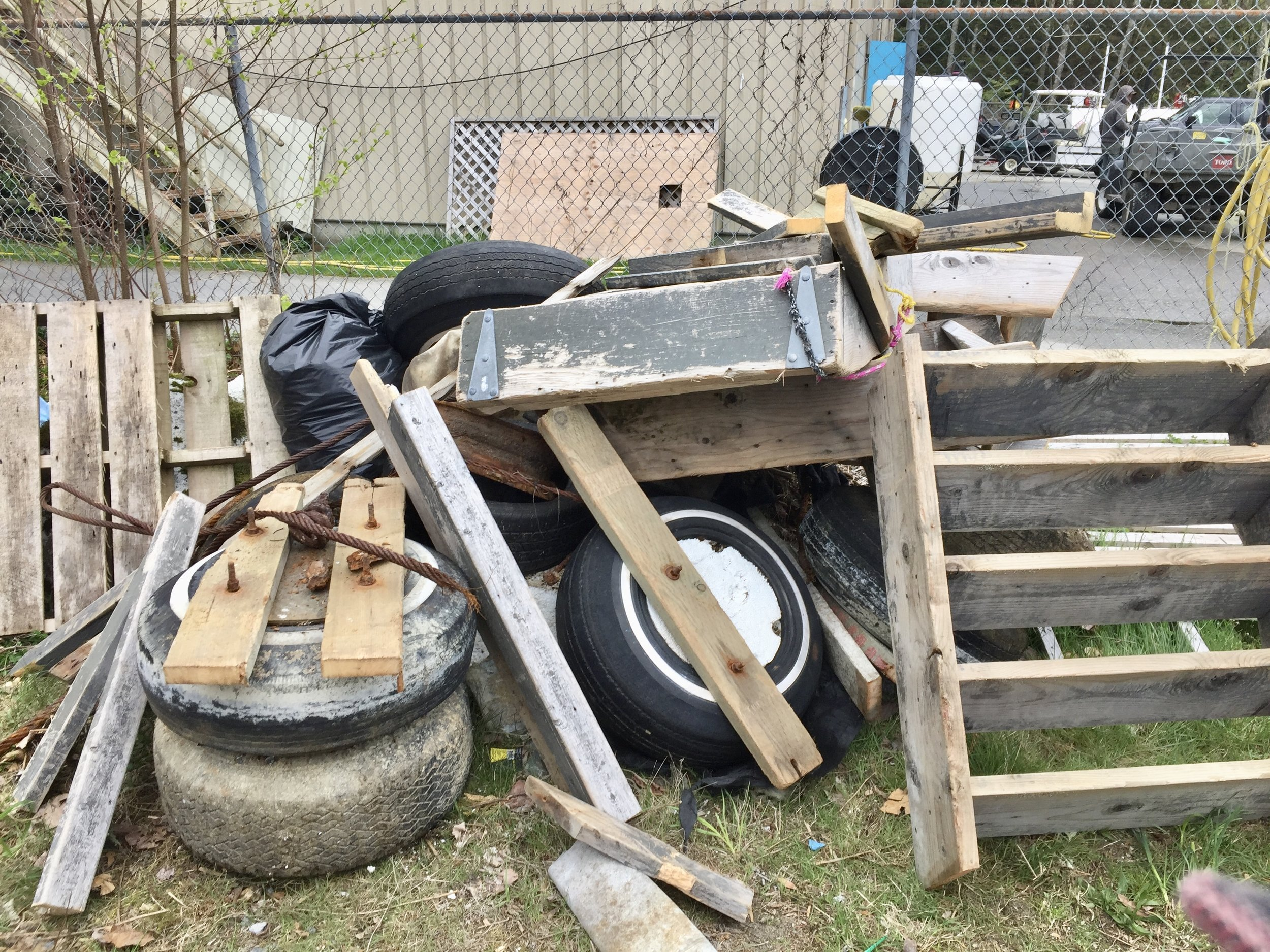 A pile of marine debris; tires embedded with styrofoam, metal and wood, pressure treated wood, metal and plastic.