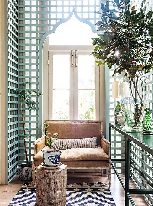 Using trellises indoors is a Southern tradition. Sara replaced the aging trellis in the house with a new one featuring a Moorish arch inspired by designer Furlow Gatewood and painted it a modern but subdued gray-green.