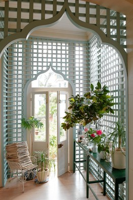 VINES OPTIONAL   The new trellis conservatory in the author's New Orleans home, complete with Moorish door arches. PHOTOGRAPH BY PAUL COSTELLO