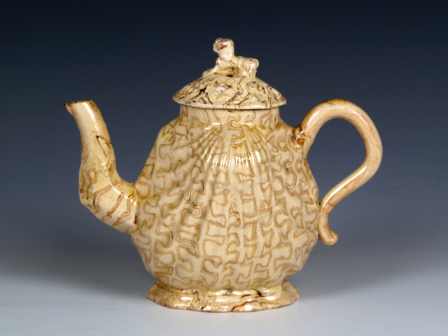 "Staffordshire Agate Ware Pecten Shell Teapot and Cover, 1750s, 5½"" (14 cm) high."