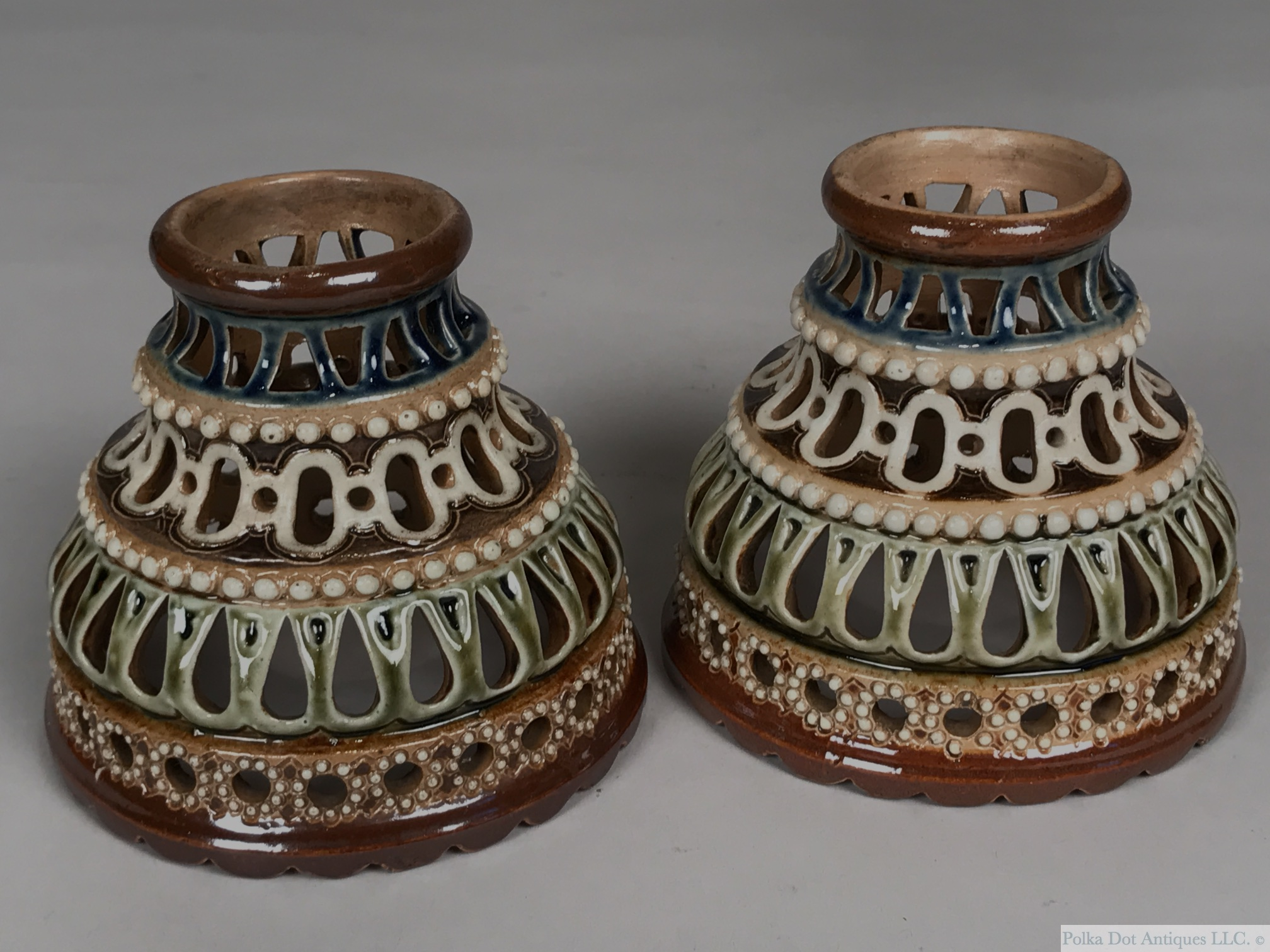 "Pair of Doulton Salt Glazed Stoneware Reticulated Lamp Shades, 1880-1900, each of dome form with four pierced bands and beaded bands in between, incised 'W.' 3½"" high.   RPW0036 - $220"