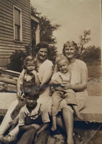 I don't have any of my photos of us kids when we were little here in Texas with me, so instead of photos of us, I'm putting up this photo of some other Willy Women, including my grandmother and my great aunt and the little ducklings in their lap (who are in their 70s and 80s now!).