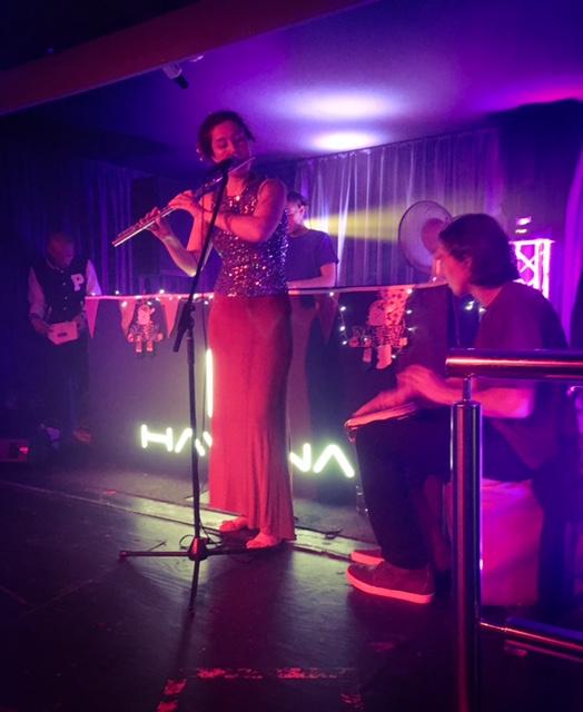 Naomi West provides a flute accompaniment to DJ Stefunk.