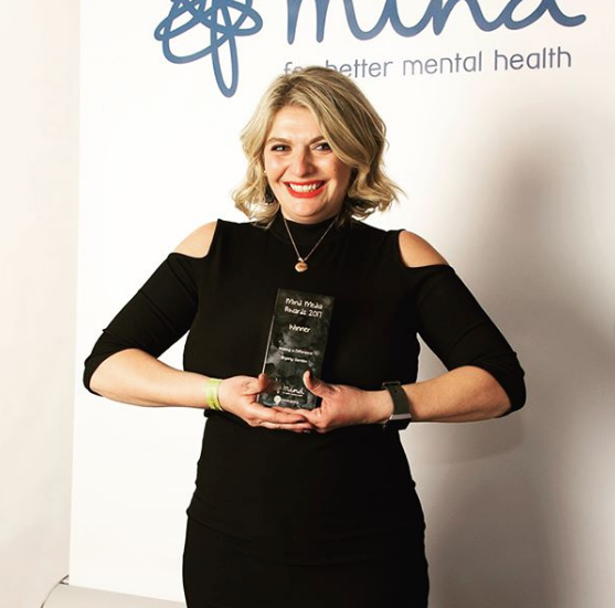 Receiving a Mind Media Award for her work in raising awareness of mental health issues