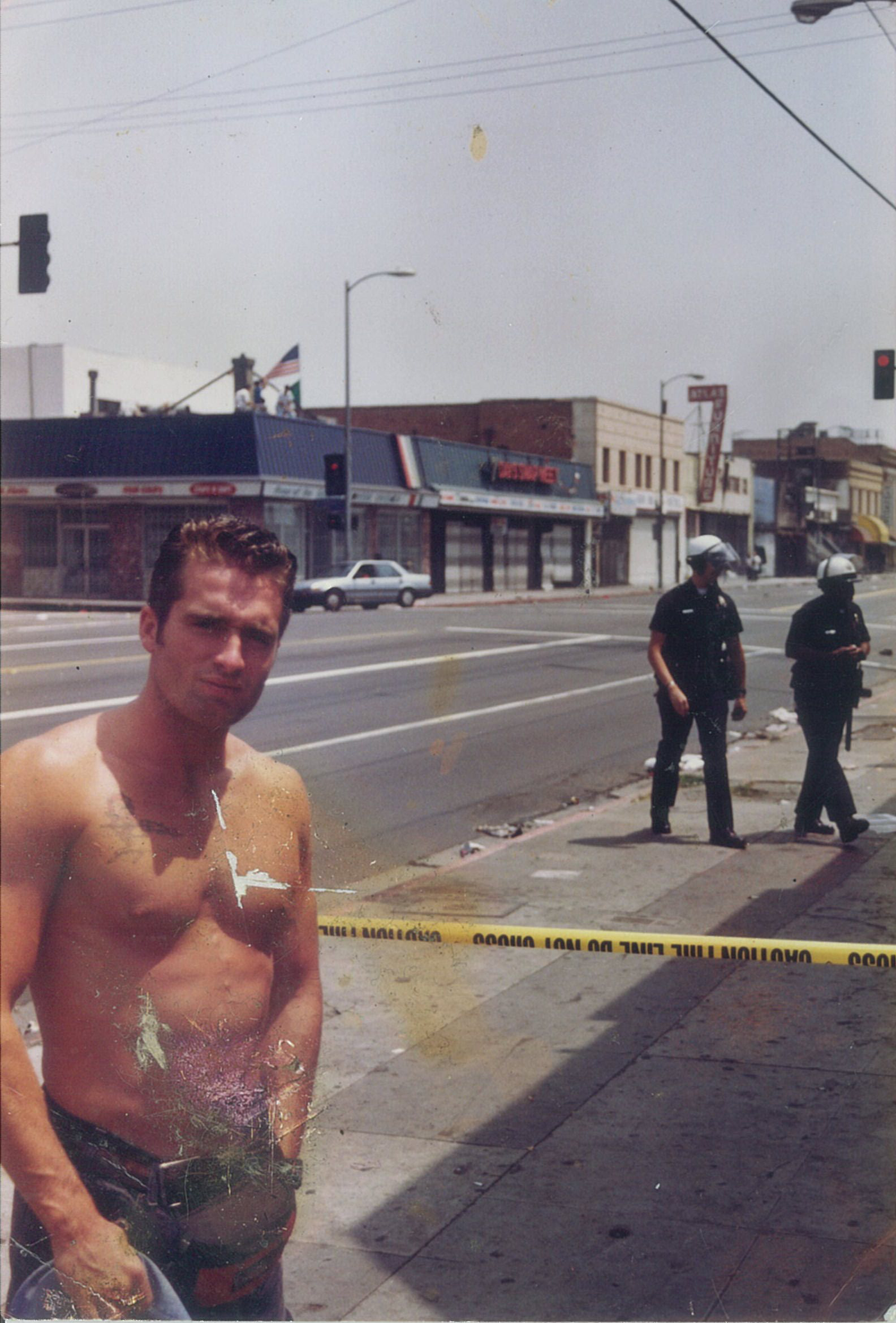 36 Jerry with cops in the back.jpg