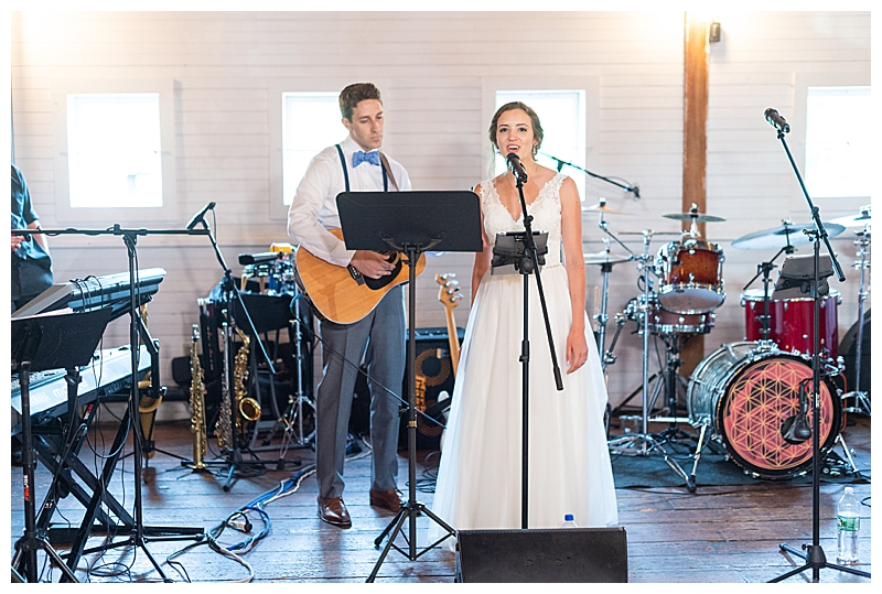 Bridge and groom sing at Gedney Farm wedding
