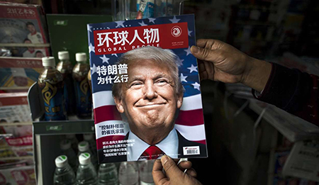 "A copy of the Chinese magazine Global People with a cover story asking ""Why did Trump win?"" in Shanghai. Photo: AFP"