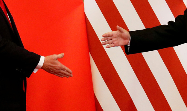 U.S. President Trump and President Xi Jinping of China shake hands after statements in Beijing, in Nov. 2017. Credit: Damir Sagolj/Reuters