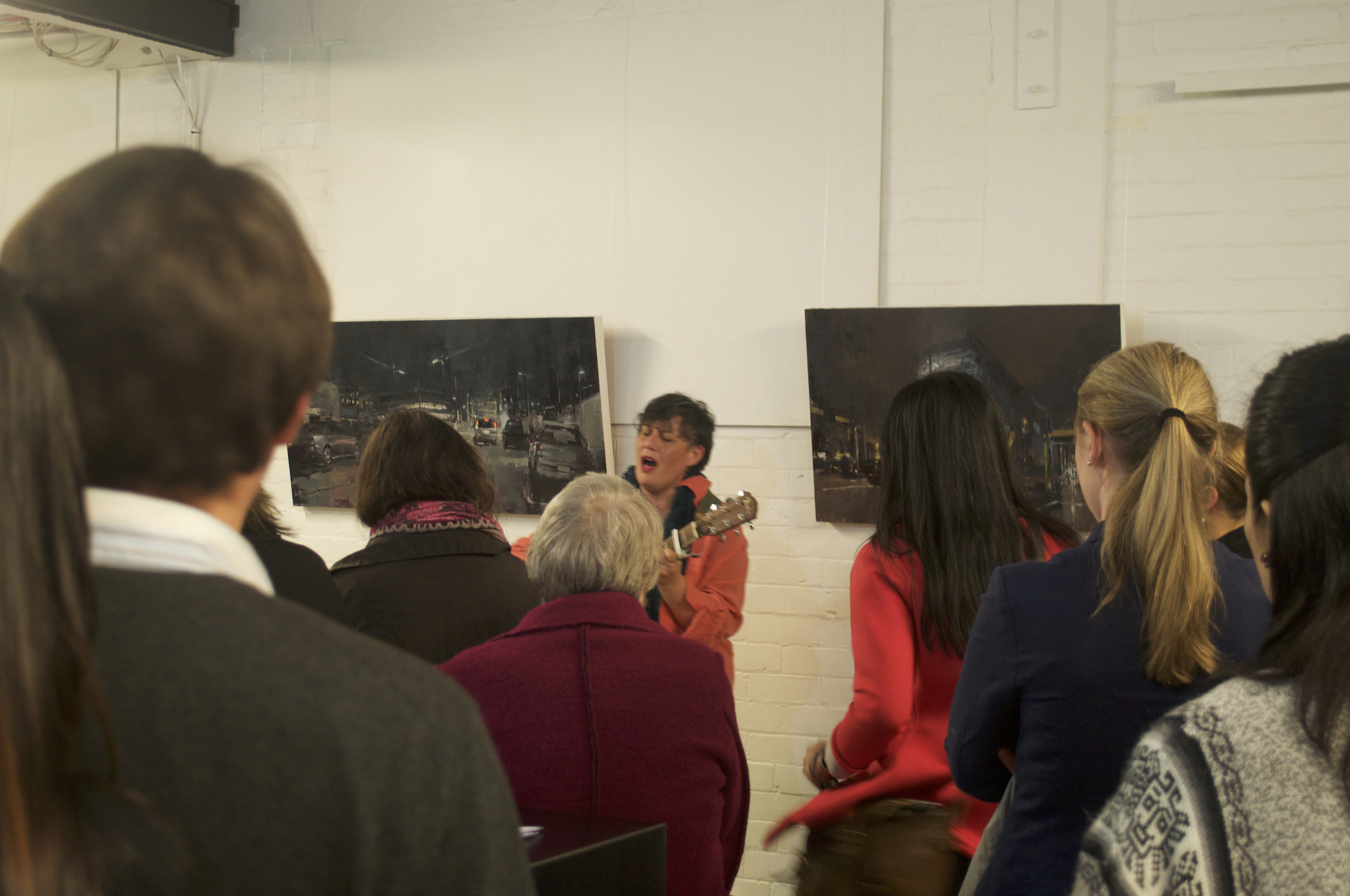 Lisa Tui performs an original piece at Liam's exhibition.