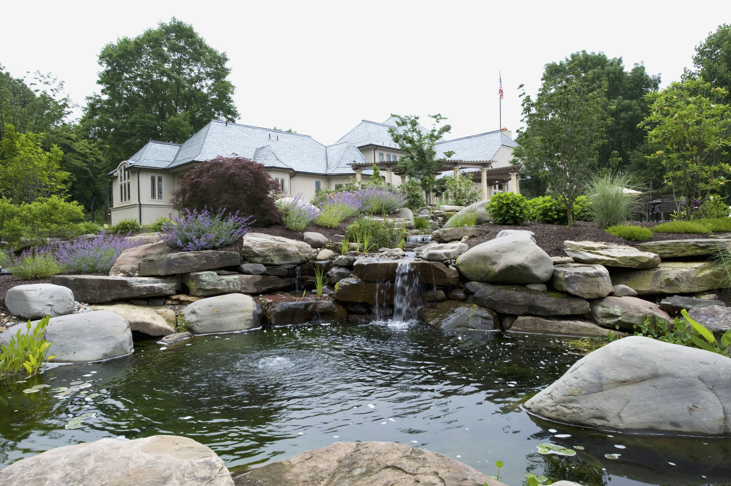 Koi pond vs Garden pond - What's the difference? — PondWorks Natural Looking Garden Pond Designs on natural looking bird baths, natural looking fencing, natural looking pond liners, natural looking waterfalls, natural looking porches, natural looking retaining walls,