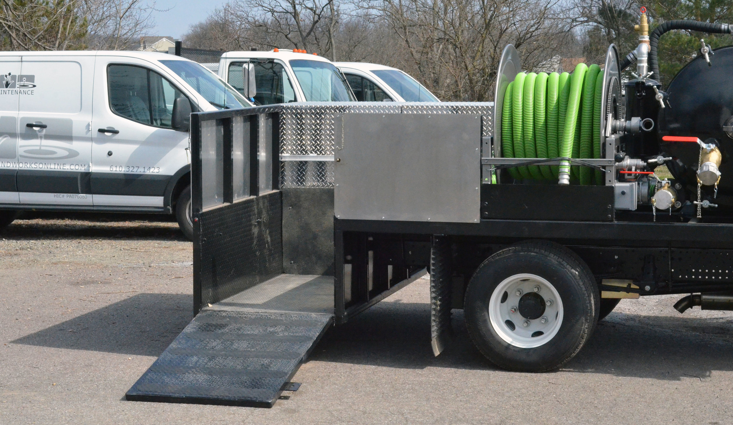Custom vacuum truck system including storage for all equipment necessary for pond maintenance