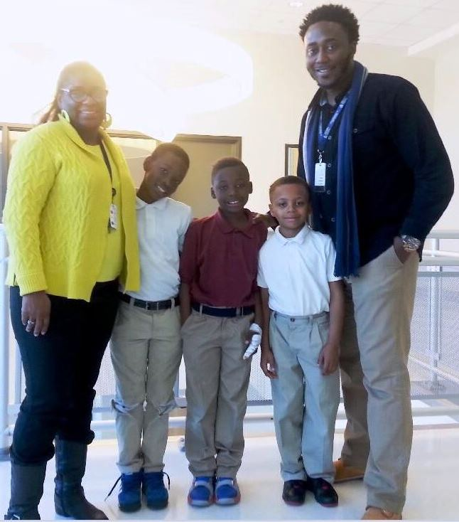 Memminger Parent Advocate Darcell White and Student Support Specialist Raymond Nelson with third-grade students Thomas McWhite, Jaycee West and Tzion Camera.