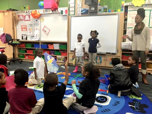 """A counselor and students in the """"Kaleidoscope""""after-school program at Memminger. Kaleidoscope is a Charleston County School District initiative that serves 4,000 students in 45 elementary schools by offering the youngsters a meal, structured activities and a safe environment while their parents are at work."""