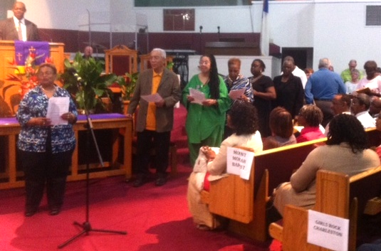 Leaders of the 30 congregations in the Charleston Area Justice Ministry declare their commitments at the CAJM rally at Mount. Moriah Baptist Church on Monday night.