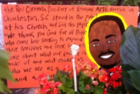 Drawing of Rev. Clementa Pinckney that mourner placed in front of Mother Emanuel within days of the massacre that claimed the lives of the pastor and eight church members during Bible study group he was leading on the evening of June 17, 2015.