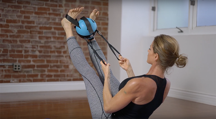 Using the loop straps and removable straps is one effective way to stretch the hamstrings
