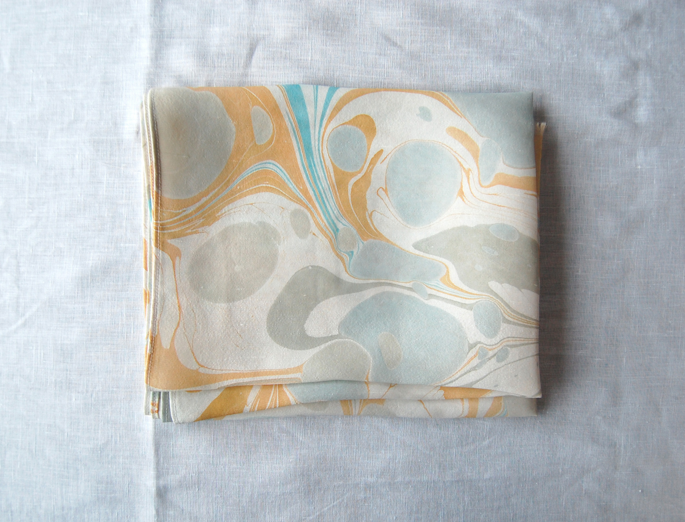 marbled silk table runner by natalie stopka
