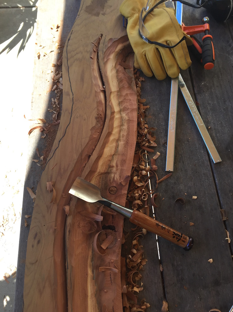 Using a Japanese wood chisel to carve the wood