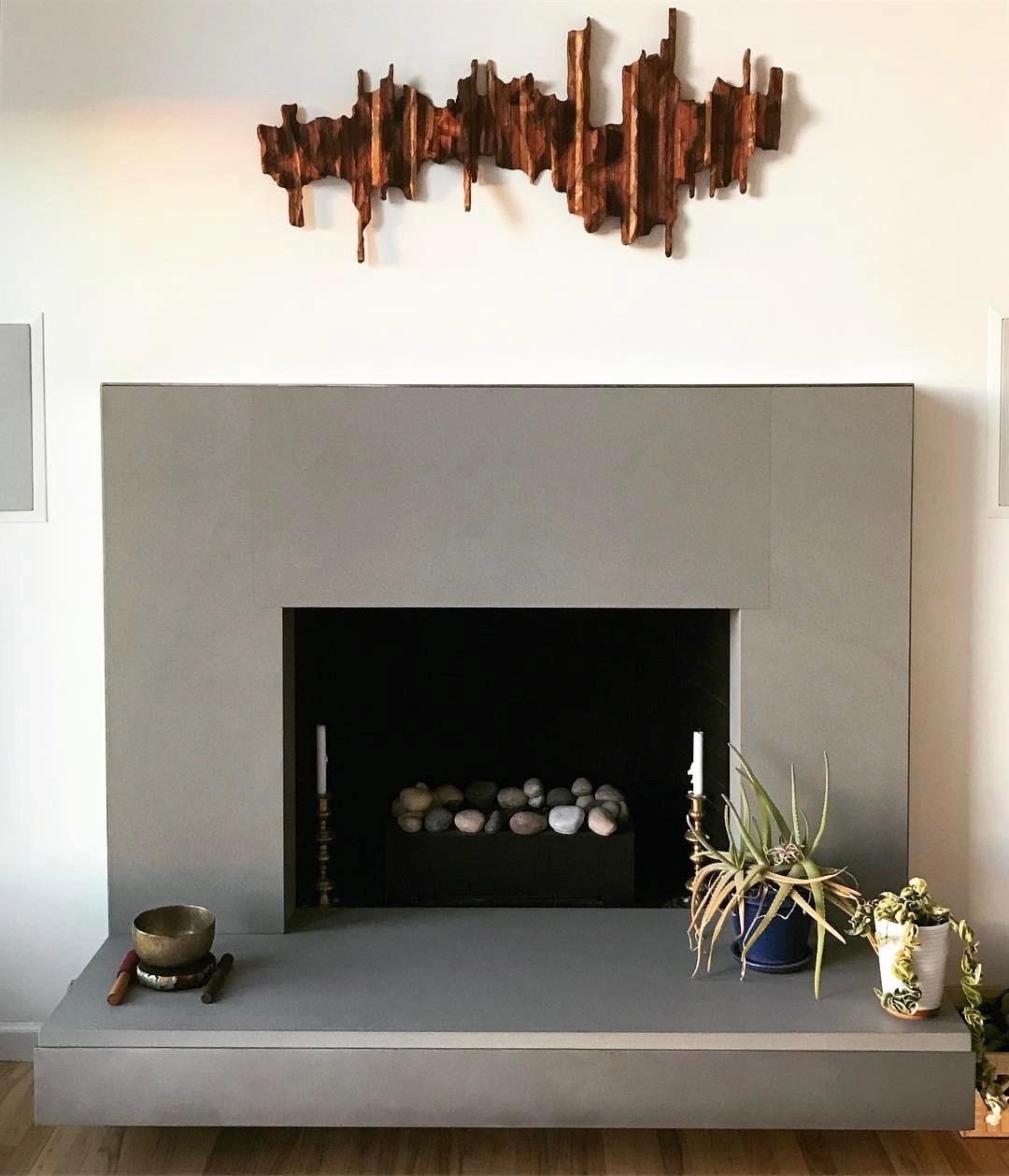 "Wooden wall art ""Mountain Ridge"" above a fireplace mantel as an idea for interior design"