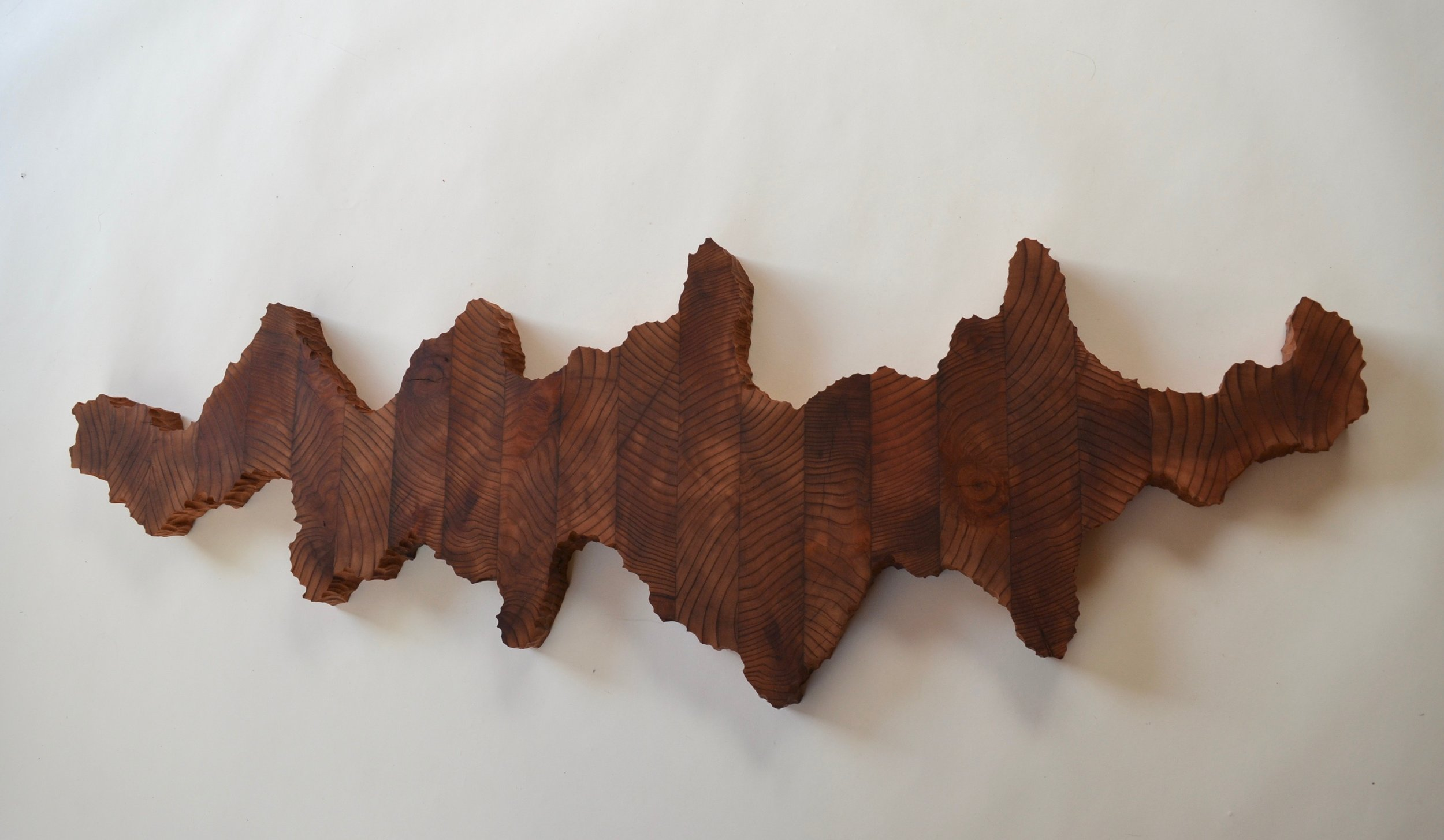 Around the World, 17x48x2, reclaimed redwood, at SFMOMA Artist Gallery