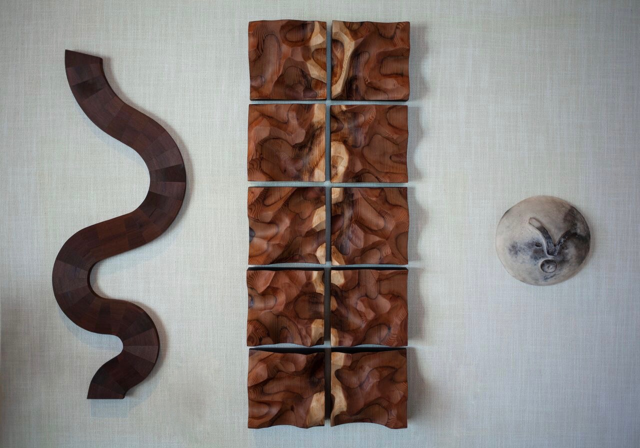 Wall sculptures by Lutz Hornischer (wood) and Carole Neilson (ceramics)