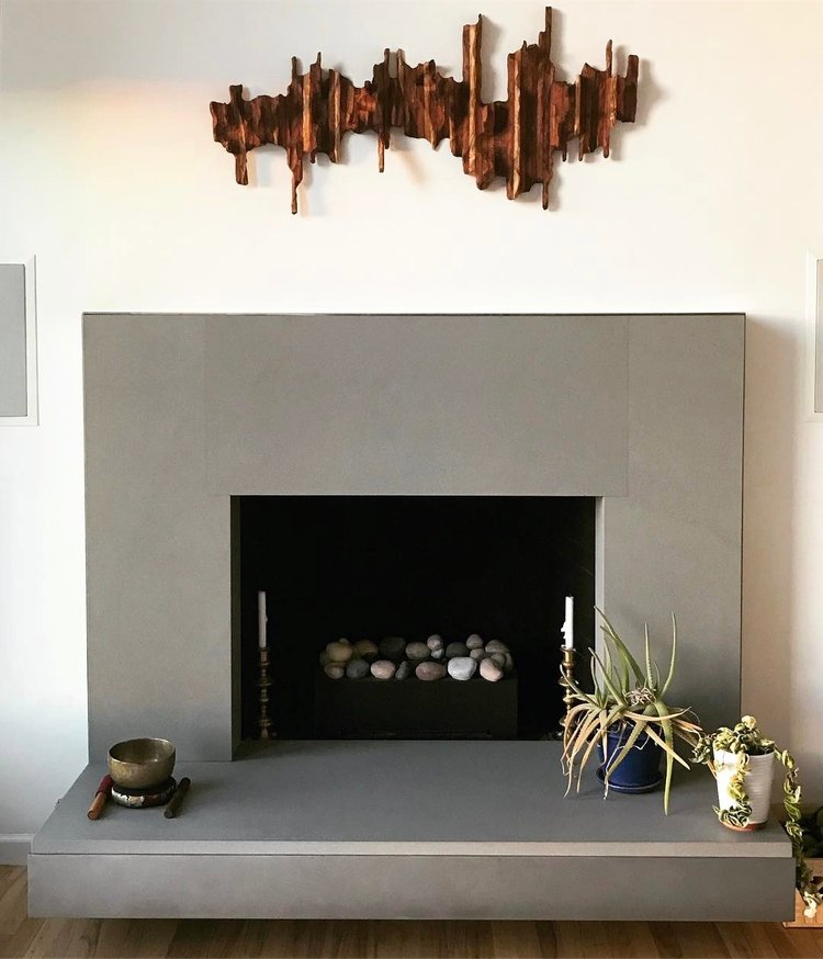 "Abstract wall sculpture ""Mountain Ridge"" above beautiful fireplace in collector home in San Francisco"