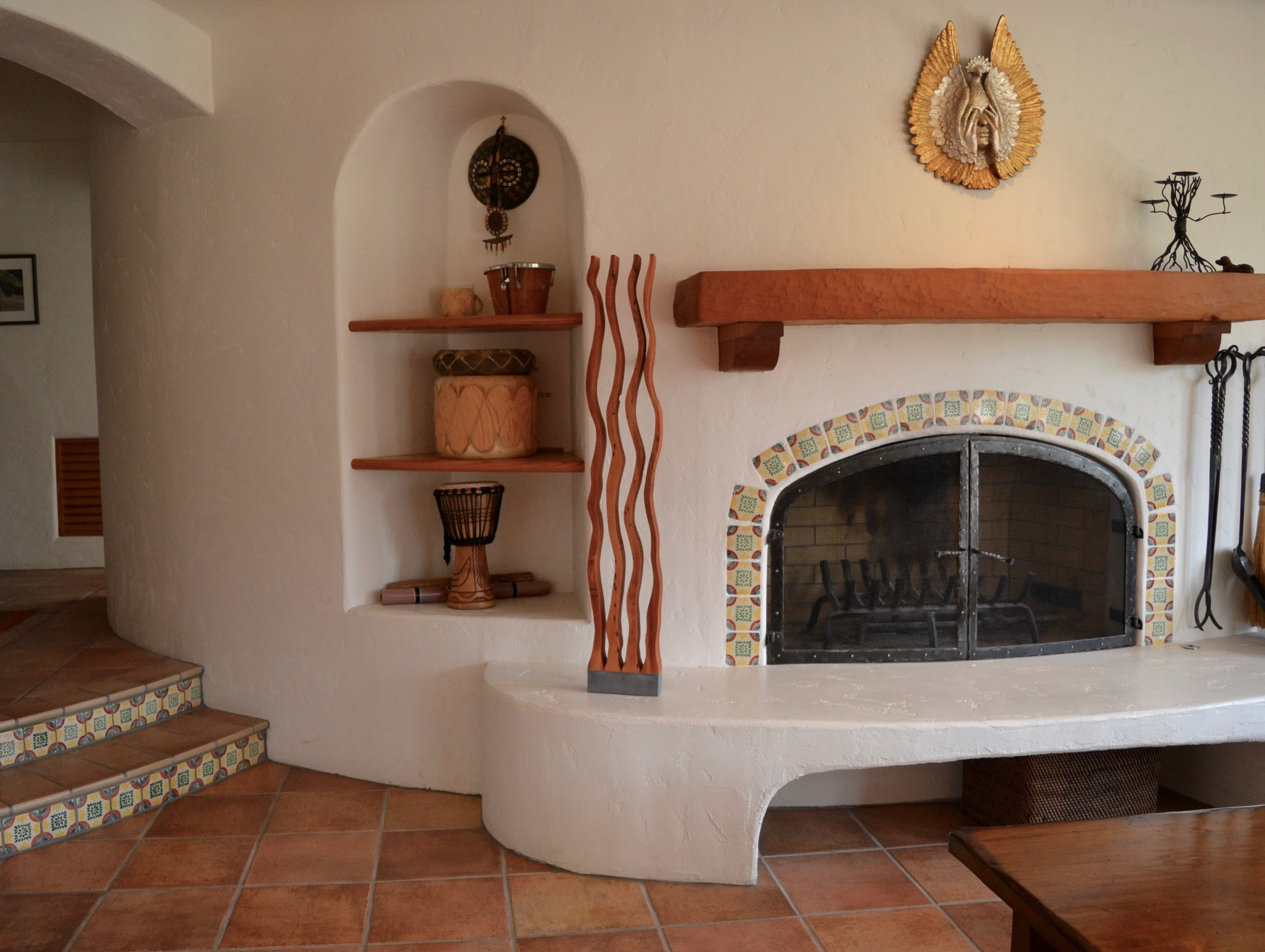 "Wooden sculpture ""Four Dancers"" next to fireplace in a Orinda residence"