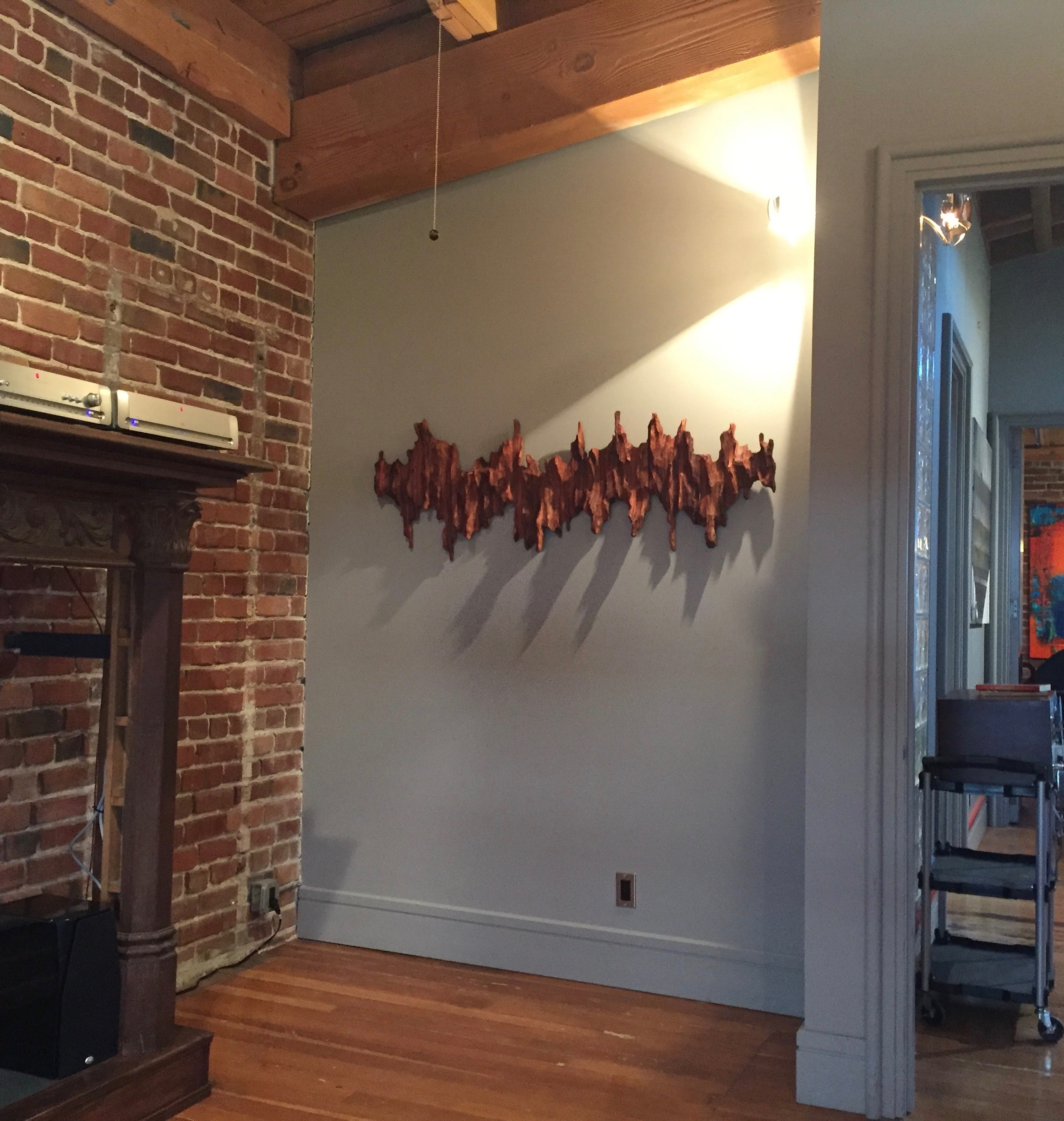 "Wall sculpture ""Soundwave II"" at corporate event space in Oakland"