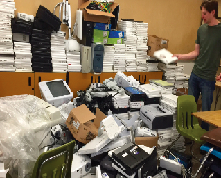 Greg Collen (IT Department), Juneau Education Support Staff (JESS) Employee Representative, surveying obsolete equipment.