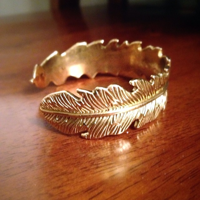 Golden feather cuff from Lockwood Shop ( read more ) in Astoria!