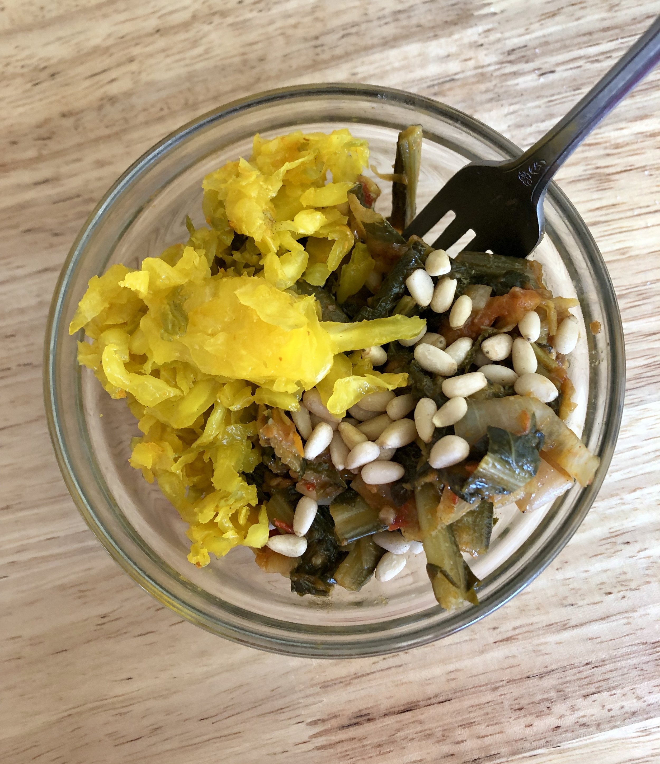 Topped with pine nuts and Turmeric-Ginger Sauerkraut