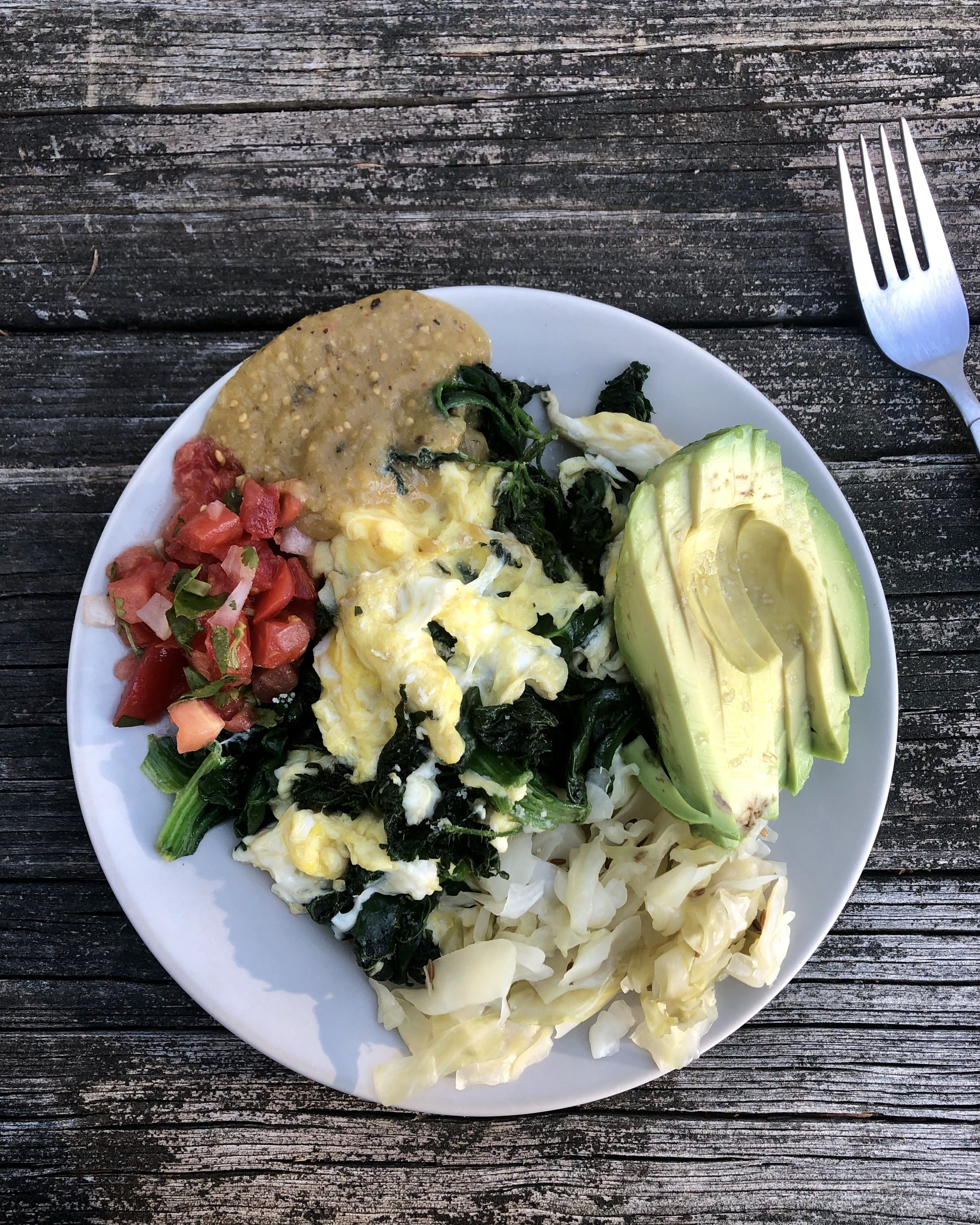 Scrambled Eggs & Nettles with avocado, 2 salsas, and sauerkraut—a nourishing and filling breakfast!