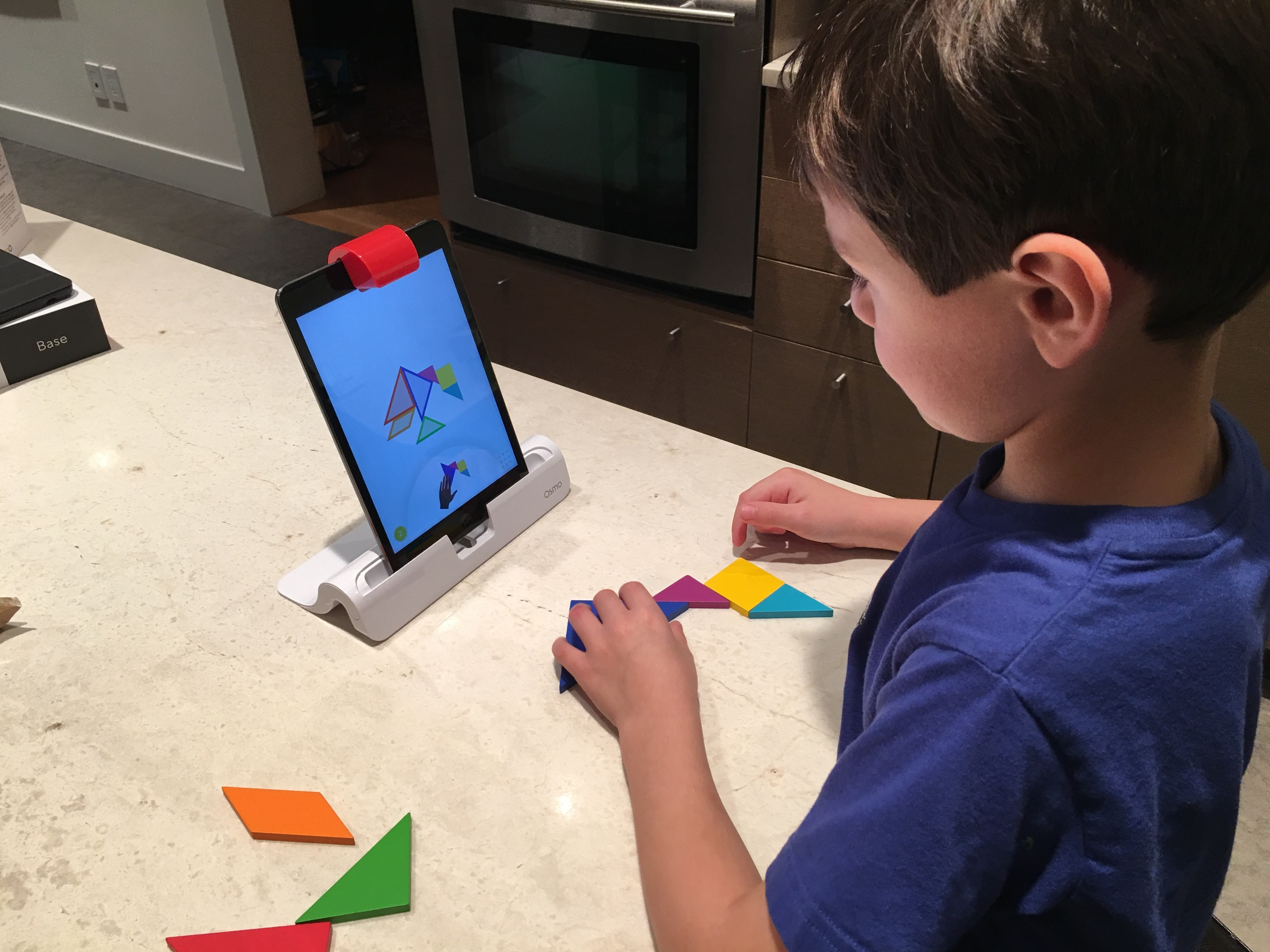 Our 5 year old playing tangram