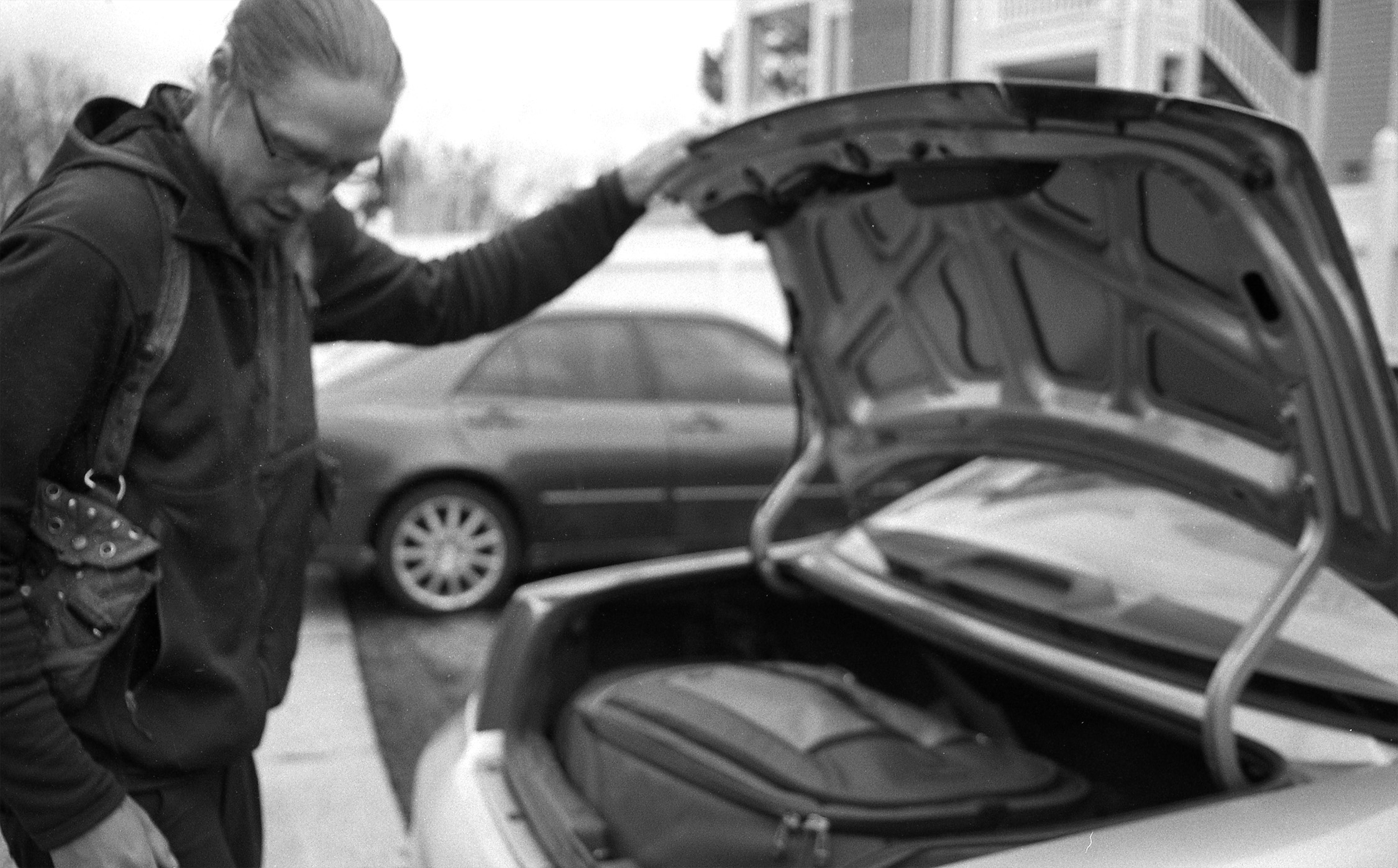 Michael Grab, 31, a stone balancing artist, closes the trunk to his car in Aurora, Colorado, in March 2016. Grab used to live out of his car for several months.