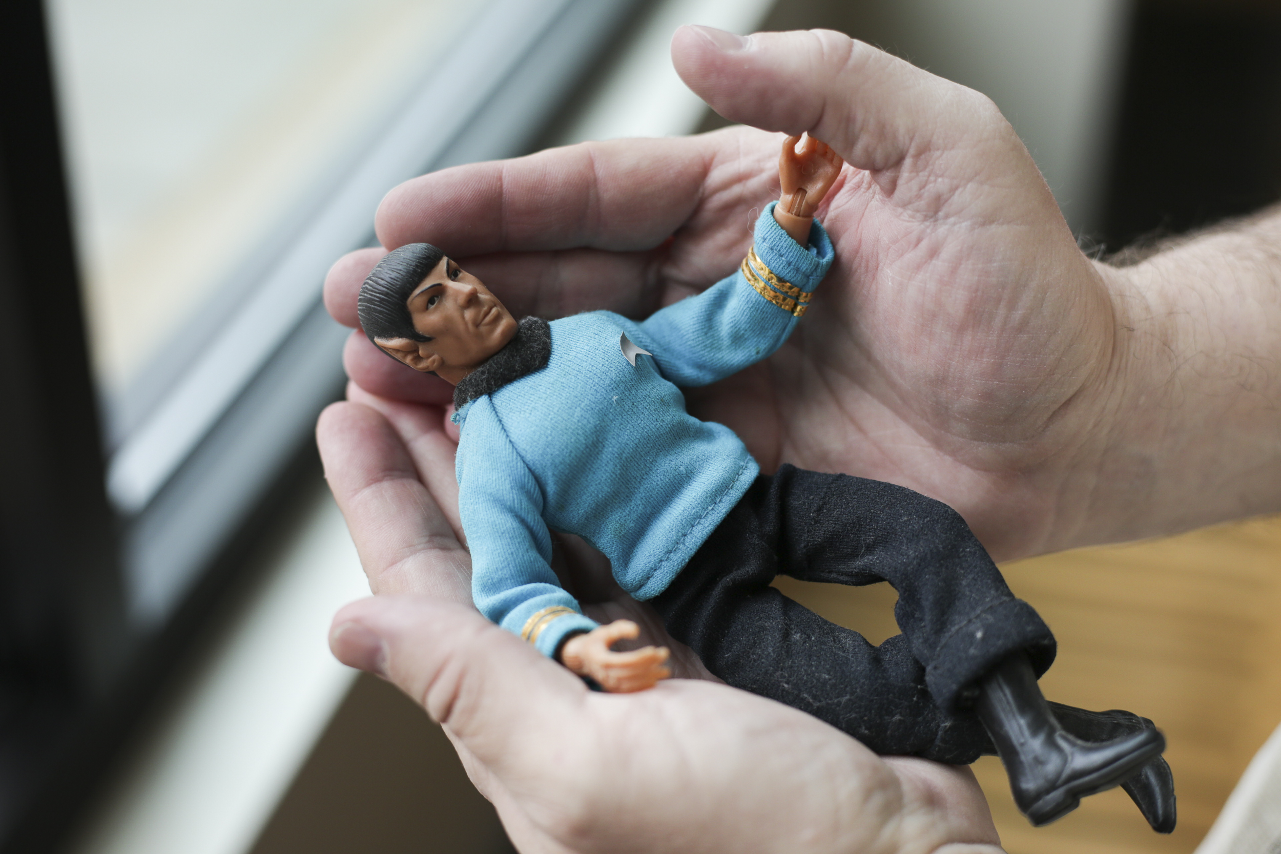Kevin Pettit, 50, holds a doll he calls Mr. Spock, in his hands at the First Congressional Church in Boulder, Colorado, on April 24, 2018. Spock is important to Pettit because he sat by his bedside all throughout the time Pettit was in coma after his accident.