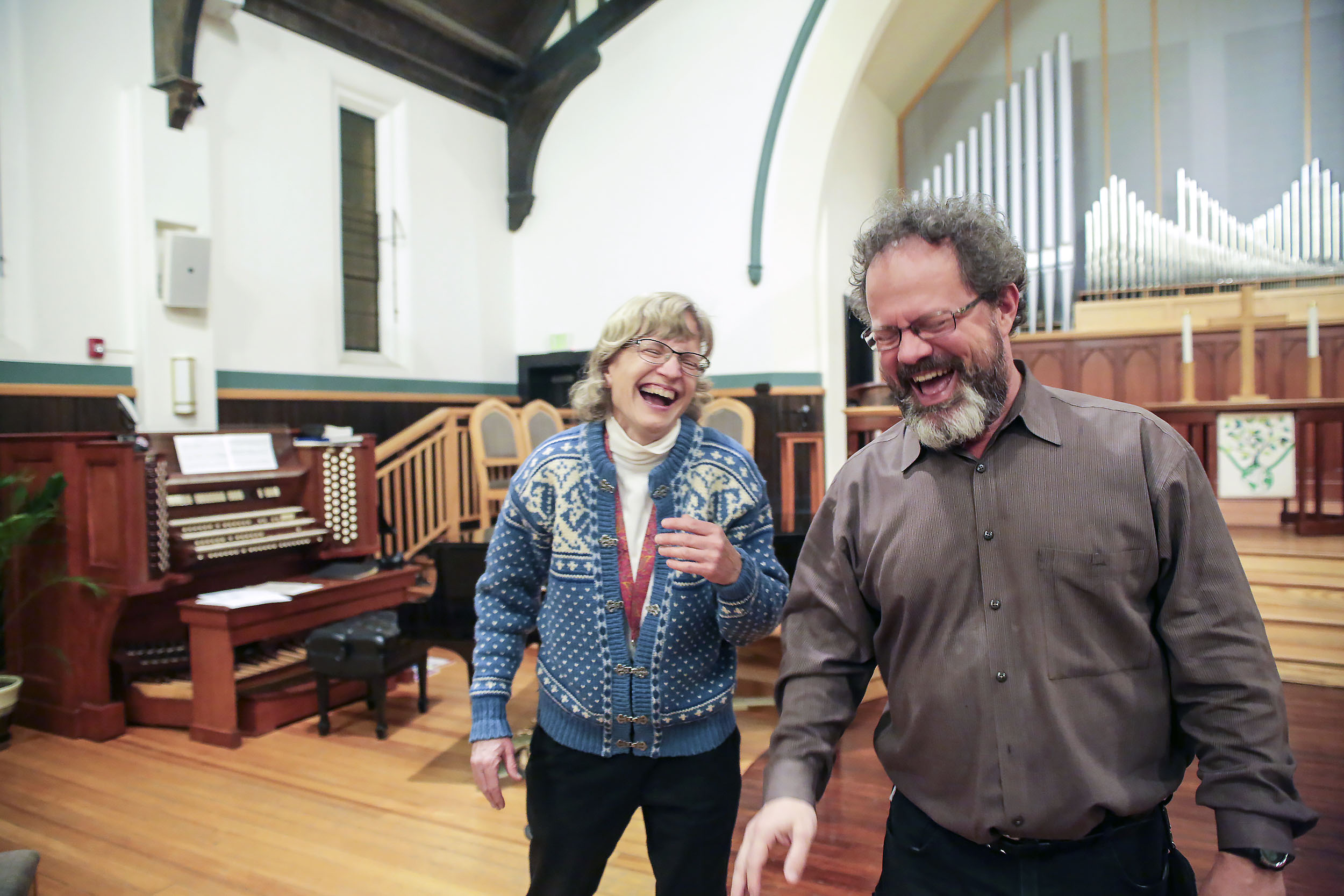 Kevin Pettit, 50, laughs with girlfriend Mary Magee after choir rehearsal at the First Congressional Church in Boulder, Colorado, on April 26, 2018. Pettit and Magee both love singing and have been together for five years.
