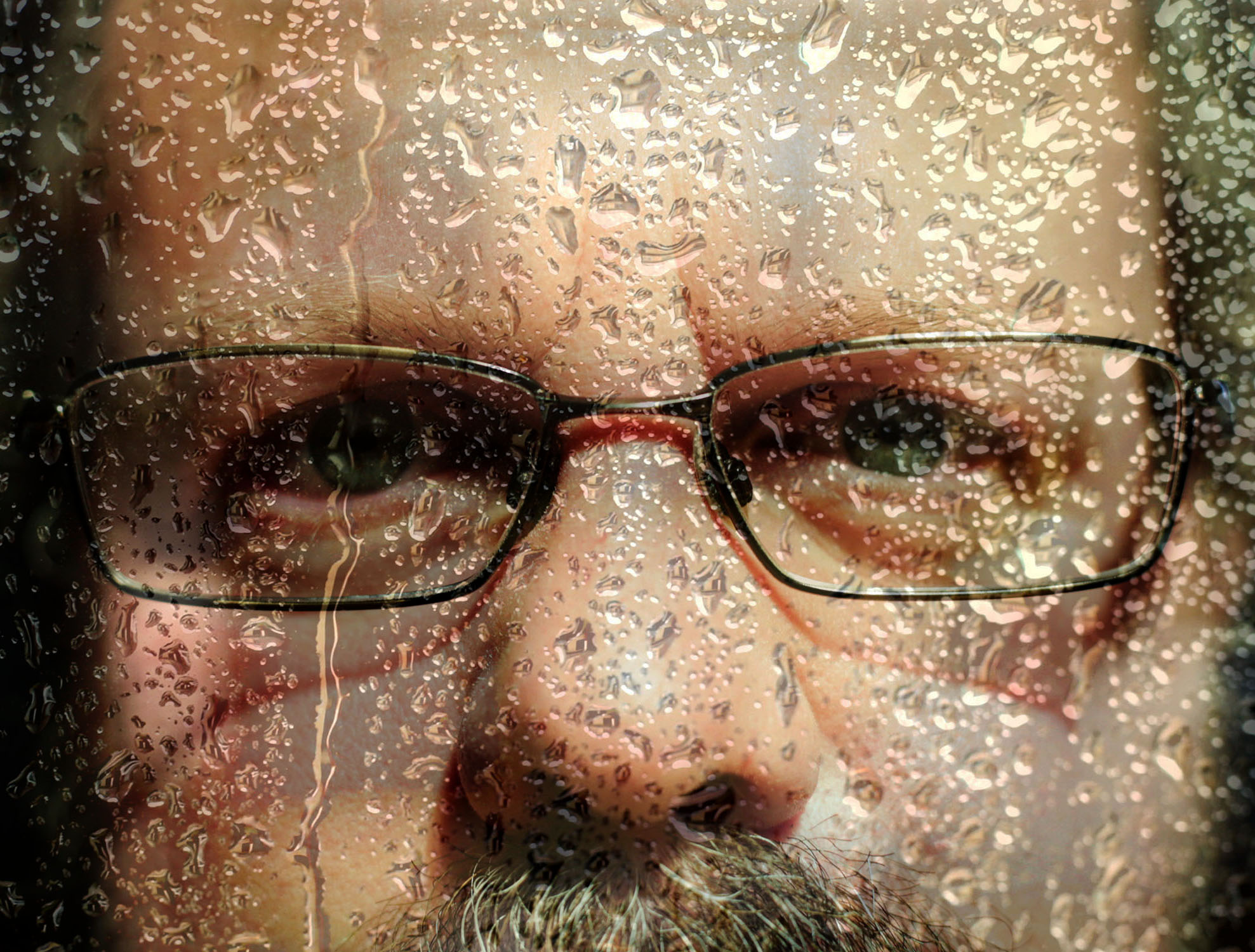 "Double exposure of Kevin Pettit and rain on a window. This image symbolizes what Pettit said it feels like to have a traumatic brain injury. ""It's almost like your thoughts are all over the place and there is a puzzle but you can't find the missing piece,"" Pettit said."