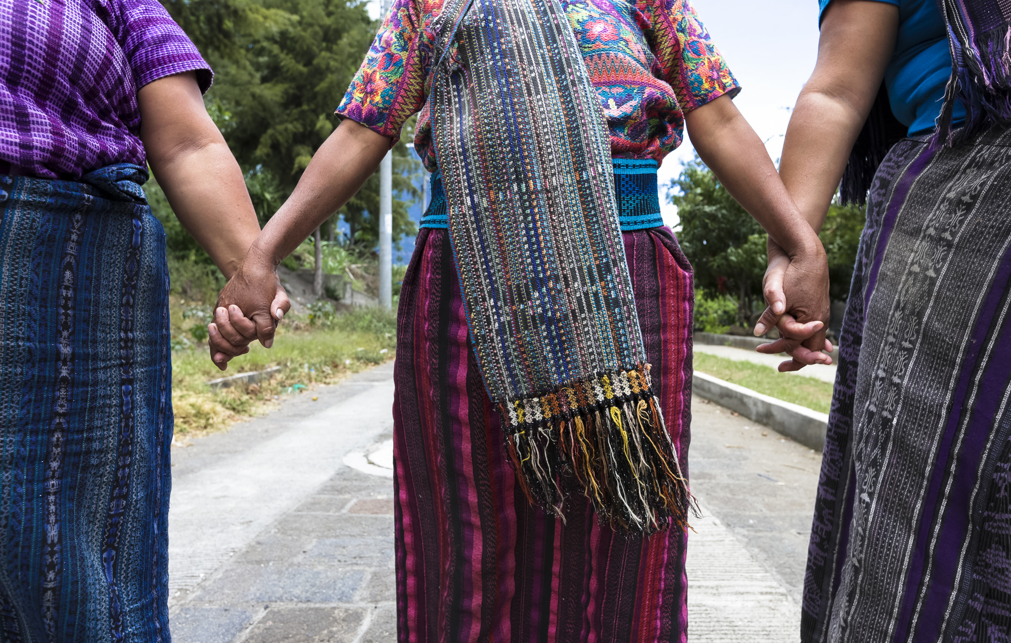 Women from Chukmuk, a close-knit community in Guatemala, gather hand and hand to show appreciation for one another on August 9, 2018. Chukmuk is a village populated by displaced survivors of the mudslides that took place on October 5, 2005, from the effects of Hurricane Stan.