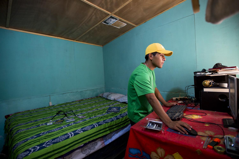 Jasy Mendoza, 23, member of Poesía Loca, works on his music in his house in San Juan La Laguna, Lake Atitlán, on December 22, 2018.