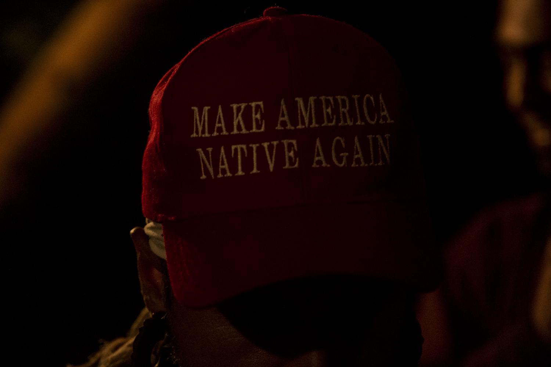 "Juan Martinez ""Dr. Nativo"" 37, from Balam Ajpu, wears a hat ""Make America Native Again"" during a freestyle collaboration in San Marcos La Laguna, Lake Atitlán, on November 26, 2018. Balam Ajpu focuses heavily on preserving native roots."
