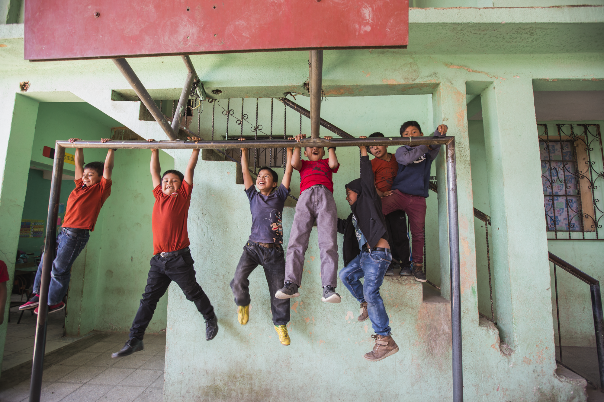 Kids hang from a soccer goal post during their lunch break at school in Tierra Linda, Guatemala. Tierra Linda is a small community up in the highlands of Guatemala where many indigenous people live.