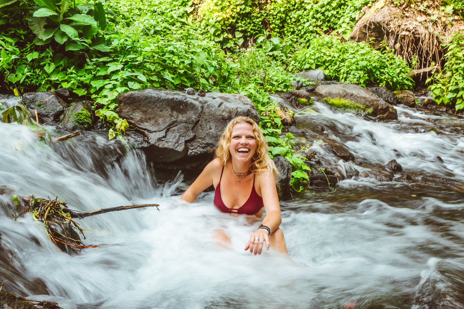 Nicole LaPorte relaxes in a river outside of San Lucas Toliman, Guatemala, with friends during a weekend camping trip.