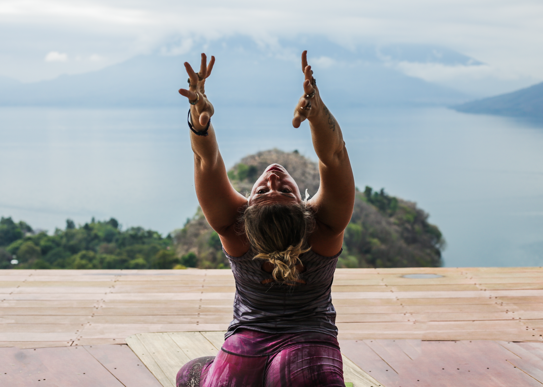 A girl does stretches during a yoga class at Eagle's Nest in San Marcos La Laguna, Guatemala.
