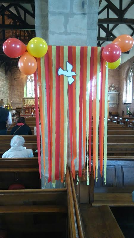 All Saints' Church recently celebrated Pentecost with balloon, banners and cake of course!