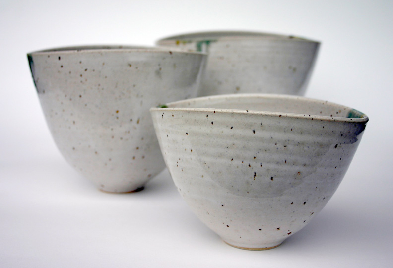 Three Tall Asymmetric Bowls; white glaze with turquoise/green/orange