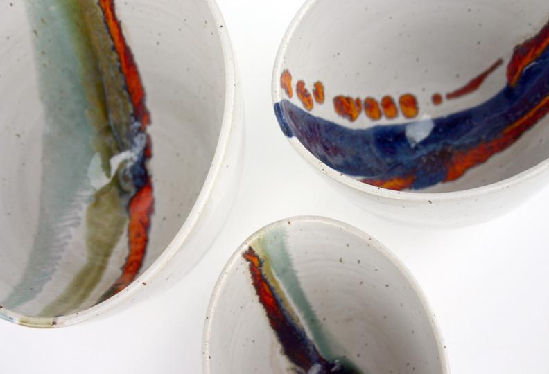 Three Tall Asymmetric Bowls; white glaze with turquoise/green/orange