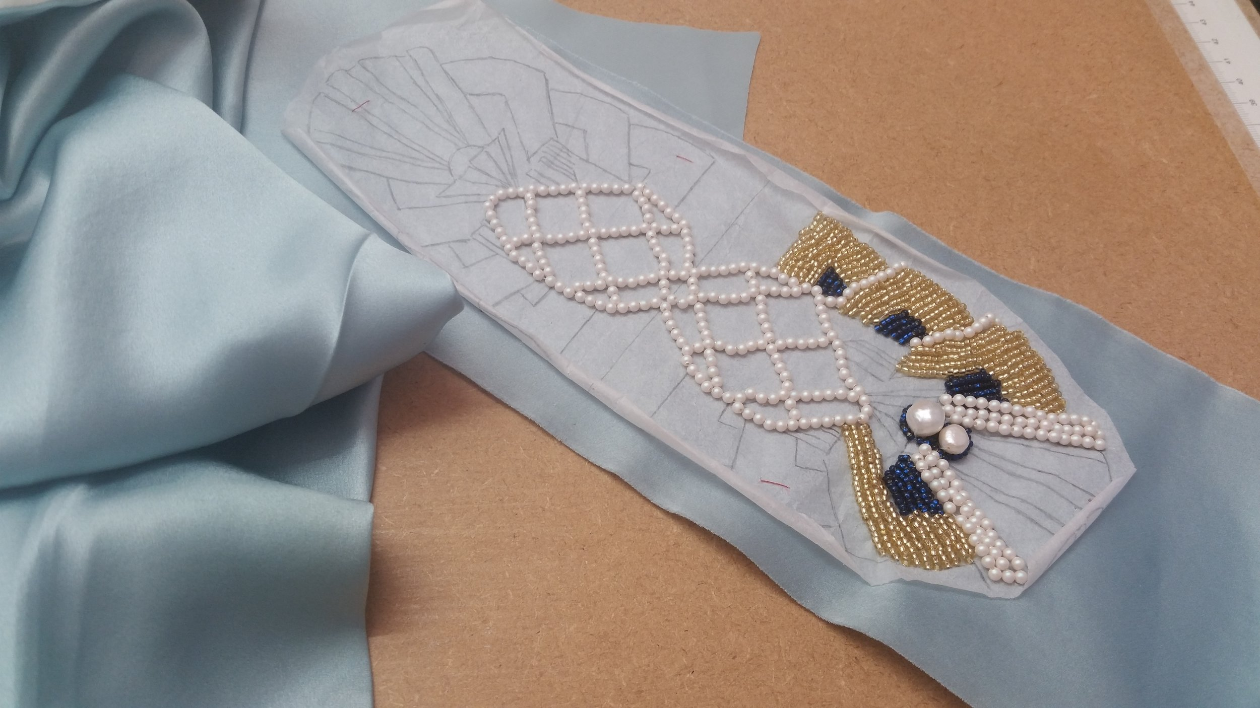 The cummerbund which alone took over 30 hours of hand beading.