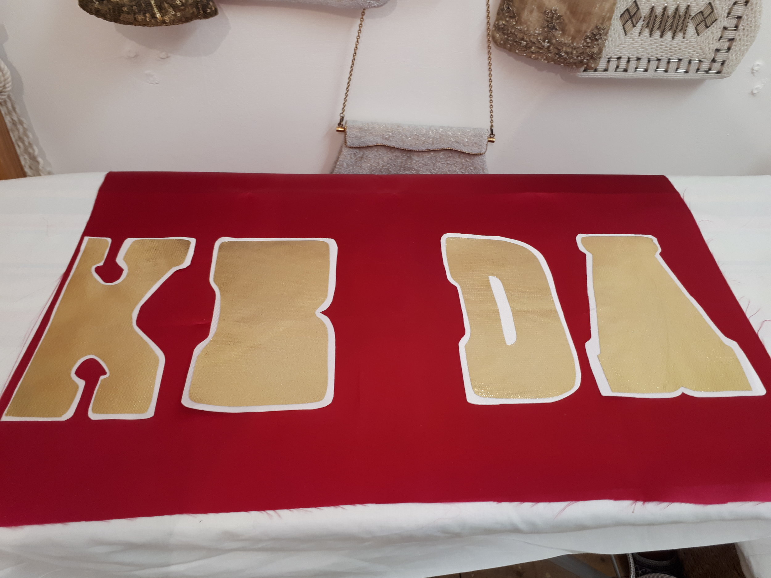 Attaching the Cake Daddy apron bow letters
