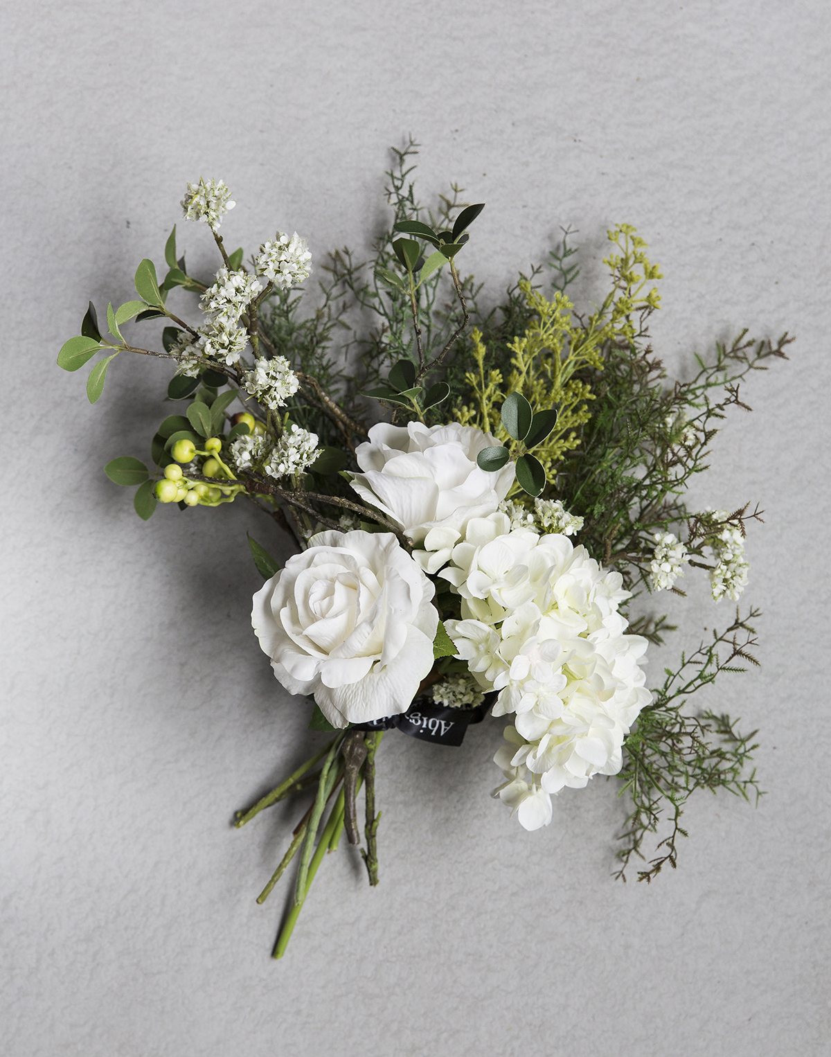 Woburn Bouquet,  Abigail Ahern , £110   Buy flowers that will last forever like these super-realistic faux bouquets from Abigail Ahern.