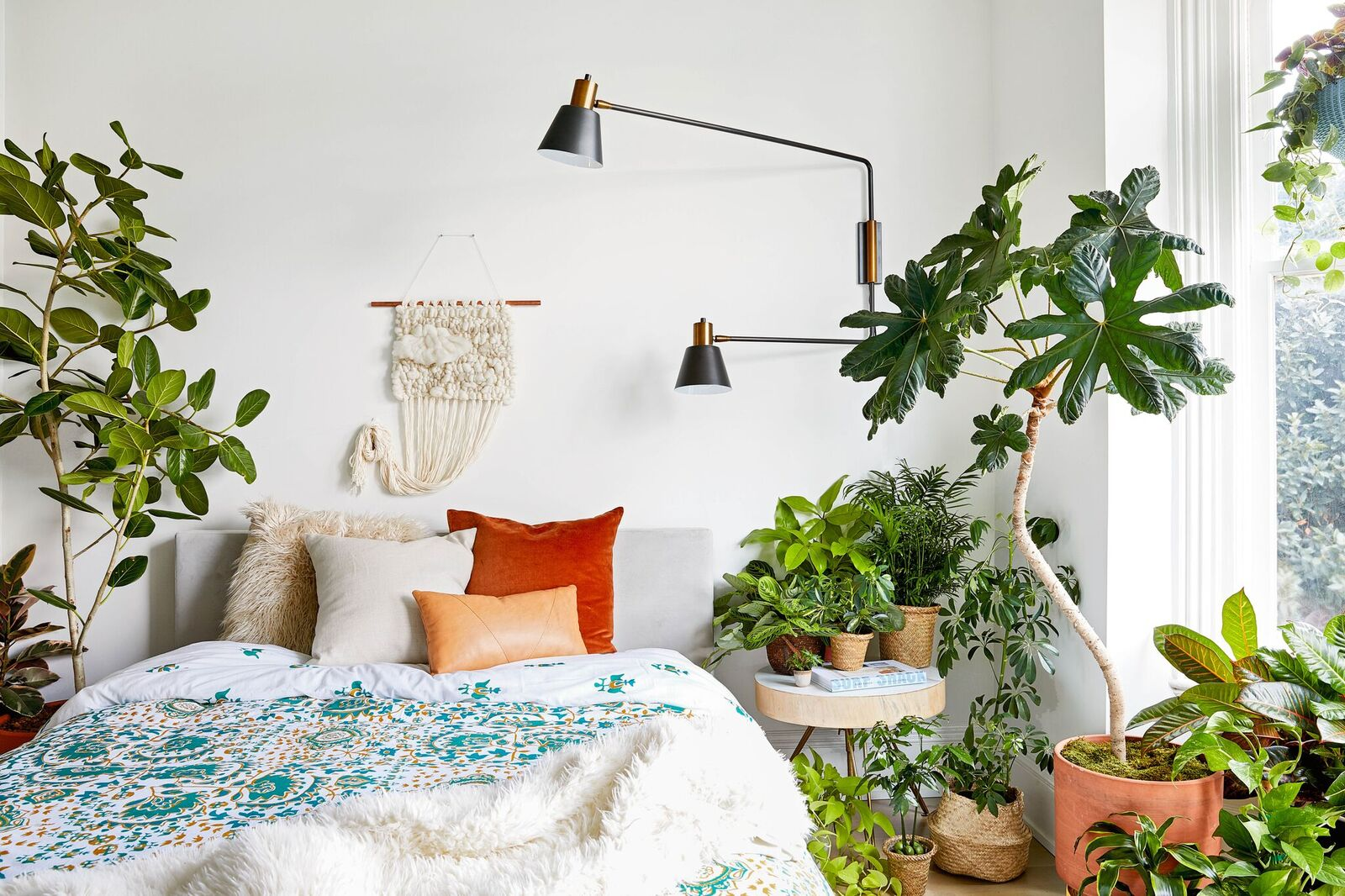 Bedroom decorated with lots of houseplants